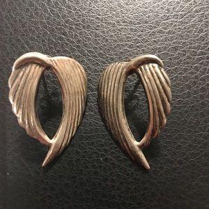 Angel wing earrings.